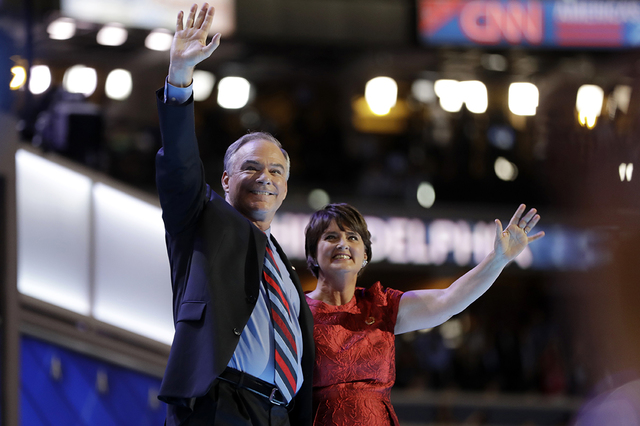 Democratic vice presidential candidate, Sen. Tim Kaine, D-Va., waves with his wife Anne Holton during the third day session of the Democratic National Convention in Philadelphia, Wednesday, July 2 ...