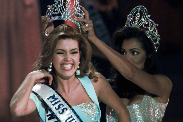 In this May 17, 1996, file photo, the new Miss Universe Alicia Machado of Venezuela reacts as she is crowned by the 1995 winner Chelsi Smith at the Miss Universe competition in Las Vegas. (Eric Dr ...