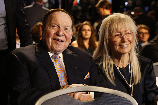 Chief Executive of Las Vegas Sands Corporation Sheldon Adelson and his wife Miriam wait for the presidential debate between Democratic presidential nominee Hillary Clinton and Republican president ...