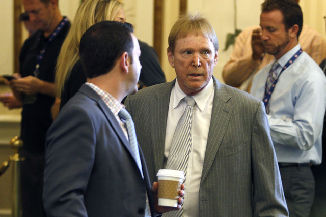 Oakland Raiders owner Mark Davis, right, makes his way into the NFL owners meeting in Charlotte N.C., on Tuesday, May 24, 2016. (AP Photo/AP)