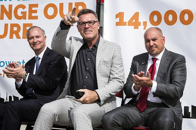 Former Oakland Raider defensive end Howie Long, center, acknowledges fans during a rally in support of the stadium Monday, Oct. 3, 2016, at Thomas and Mack Center. On his left is Steve Hill, chair ...