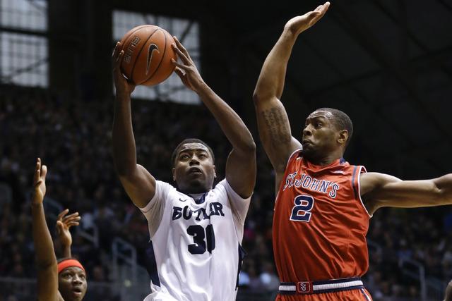 Butler forward Kelan Martin (30) shoots under St. John's forward Christian Jones (2) in the first half of an NCAA college basketball game in Indianapolis, Saturday, Jan. 16, 2016. (Michael Conroy/AP)
