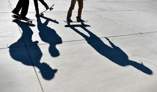 Jevon Johnson, left, Jamieson Bentley and Abraham Castillo ride their skateboards at Green Valley High School in Henderson. (David Becker/Las Vegas Review-Journal Follow @davidjaybecker)