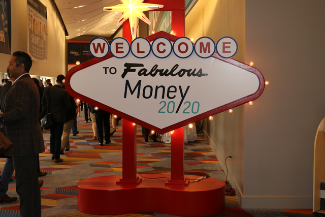 Money 20/20 attendees file into the convention center behind the Vegas-themed welcome sign at the Venetian Tuesday Oct. 25, 2016. (Nicole Raz/Las Vegas Review-Journal)