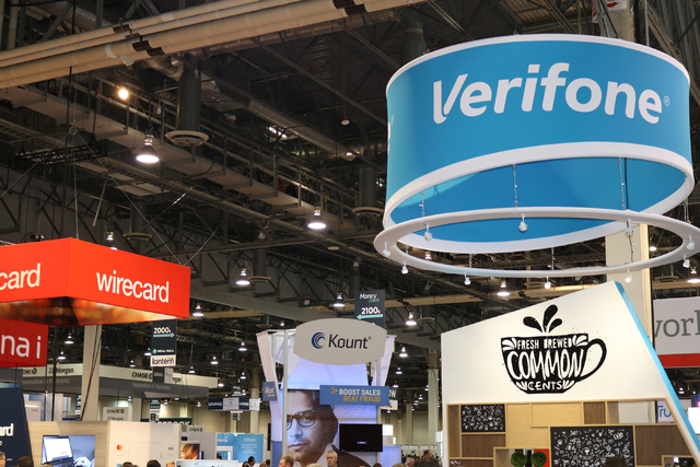 """""""FinTech,"""" the blend of finance and technology, is represented by a variety of industry booths on the exhibition floor of Money 20/20 at the Venetian Tuesday Oct. 25, 2016. (Nicole Raz/Las Vegas R ..."""