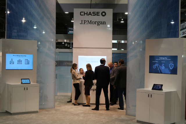 Attendees of Money 20/20, the global conference dedicated to finance and technology, visit the Chase, JP Morgan booth on the exhibit floor at the Venetian Tuesday Oct. 25, 2016. (Nicole Raz/Las Ve ...