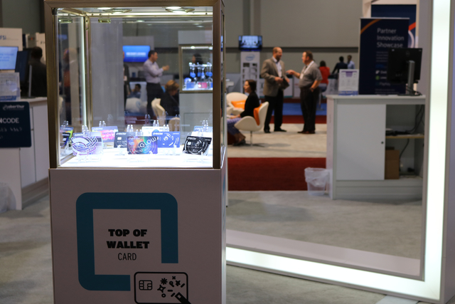 """Oberthur Technologies displayed """"top of wallet"""" cards on the Money 20/20 exhibit floor at the VenetianTuesday Oct. 25, 2016 at Money 20/20 the Venetian. """"It's a way for banks to differentiate them ..."""