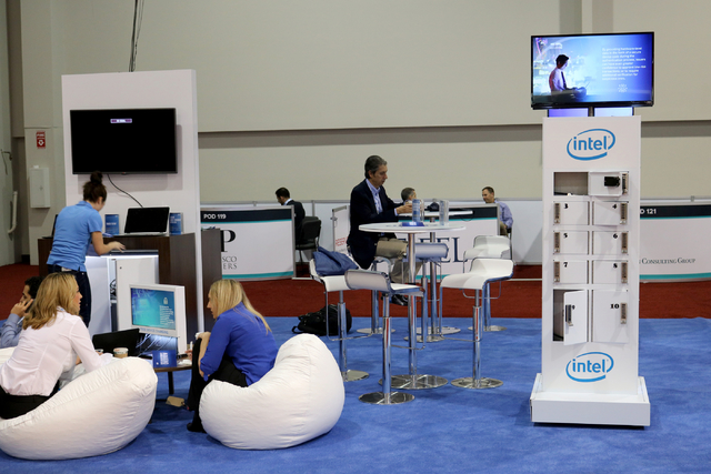 Attendees of Money 20/20, the global conference dedicated to finance and technology, visit theIntel recharge station on the exhibit floor at the Venetian Tuesday Oct. 25, 2016. (Nicole Raz/Las Veg ...