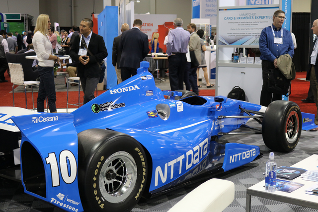 A Formula 1 race car attracted visitors to NTT DATA Consulting, Inc's booth on the exhibition floor Tuesday Oct. 25, 2016 during Money 20/20 held at the Venetian. (Nicole Raz/Las Vegas Review-Journal)