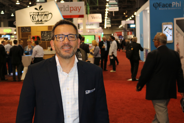 Sam Maule, senior practice lead at NTT DATA Consulting Inc., stands at the front of the exhibition floor of Money 20/20 Tuesday Oct. 25, 2016 at The Venetian. Maule moderated a panel Tuesday about ...