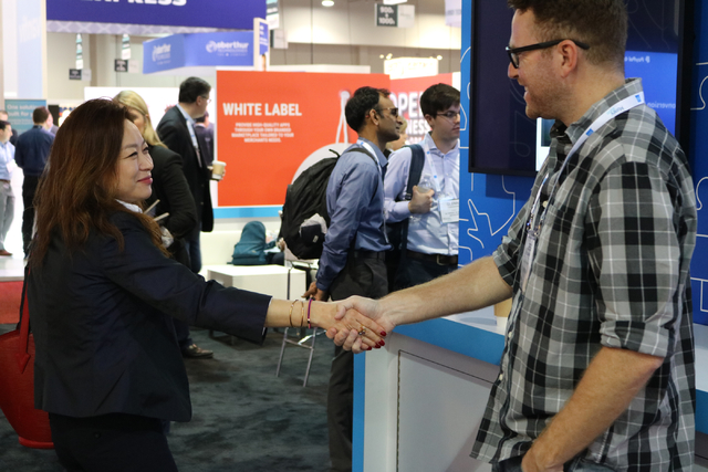 """Jian Ham, left, with KONA I Co., LTD discusses a partnership between Facebook and PayPal with Greg Crescimanno with PayPal during Money 20/20 Tuesday Oct. 25, 2016 at the Venetian. """"Now you can sh ..."""