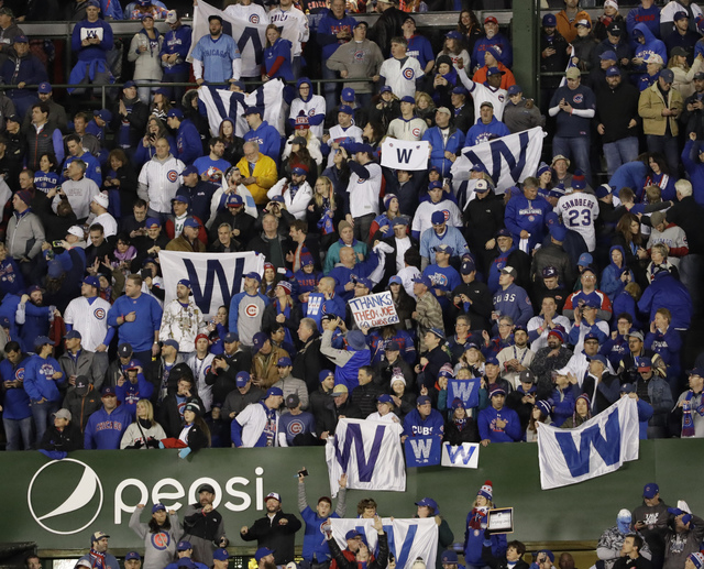 Fans celebrate after Game 5 of the World Series between the Cleveland Indians and the Chicago Cubs Sunday, Oct. 30, 2016, in Chicago. (David J. Phillip/The Associated Press)