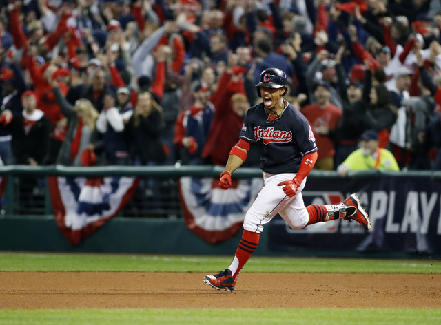 FILE - In this Friday, Oct. 14, 2016, file photo, Cleveland Indians' Francisco Lindor rounds the bases on his two-run home run against the Toronto Blue Jays during the sixth inning in Game 1 of ba ...