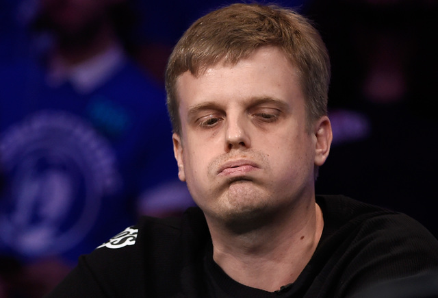Vojtech Ruzicka of the Czech Republic signs after winning after an all in bet during the final table of the Main Event at the World Series of Poker at the Rio hotel-casino, Sunday, Oct. 30, 2016,  ...
