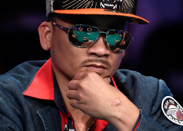 Qui Nguyen of Las Vegas ponders his bet during the final table of the Main Event at the World Series of Poker at the Rio hotel-casino, Sunday, Oct. 30, 2016, in Las Vegas. David Becker/Las Vegas R ...