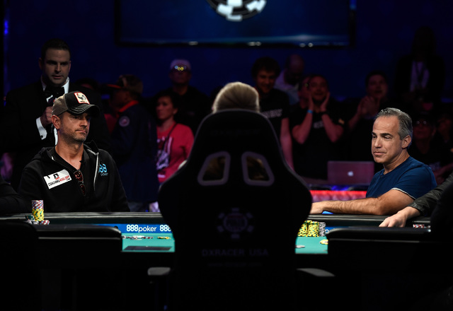 Fernando Pons of Spain, left, and Cliff Josephy of N.Y. face-off in an all in hand during the final table of the Main Event at the World Series of Poker at the Rio hotel-casino, Sunday, Oct. 30, 2 ...