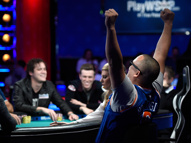 Jerry Wong of N.Y. reacts after winning a hand during the final table of the Main Event at the World Series of Poker at the Rio hotel-casino, Sunday, Oct. 30, 2016, in Las Vegas. David Becker/Las  ...