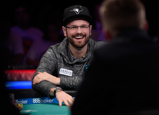 Griffin Benger of Canada smiles after winning a hand during the final table of the Main Event at the World Series of Poker at the Rio hotel-casino,  Sunday, Oct. 30, 2016, in Las Vegas. David Beck ...