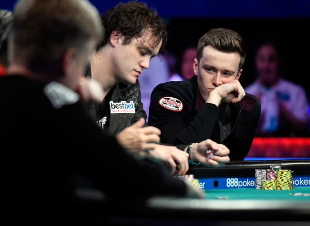 Michael Ruane, left, of N.J. and Gordon Vayo of San Francisco compete during the final table of the Main Event at the World Series of Poker at the Rio hotel-casino, Sunday, Oct. 30, 2016, in Las V ...