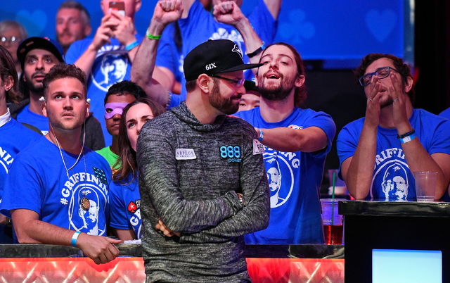 Griffin Benger of Canada reacts with his supporters after being eliminated during the final table of the Main Event at the World Series of Poker at the Rio hotel-casino, Sunday, Oct. 30, 2016, in  ...