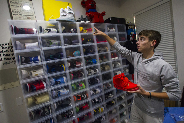 Sixteen-year-old Blake Wynn holds his Nike Air Yeezy 2 Red October shoes while talking about collecting and reselling sneakers at his home in the Summerlin area of Las Vegas on Wednesday, Oct. 5,  ...