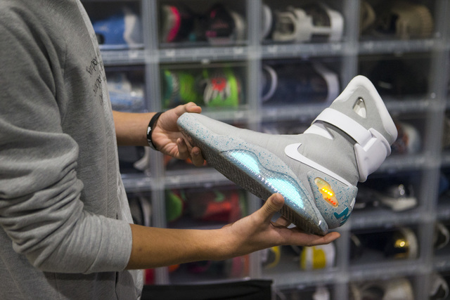 """Sixteen-year-old Blake Wynn holds his Nike Mag """"'Back to the Future"""" shoes while talking about collecting and reselling sneakers at his home in the Summerlin area of Las Vegas on ..."""