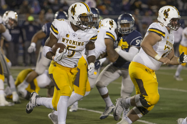 Wyoming running back Brian Hill runs in the second half of an NCAA college football game against UNR on Saturday, Oct. 22, 2016 in Reno. (Tom R. Smedes/AP)