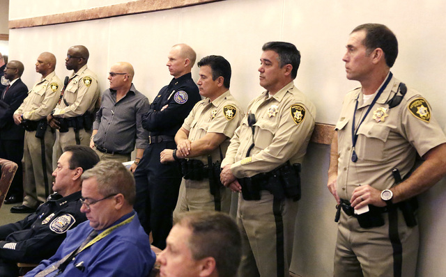 Metro police officers attend a Clark County Commission meeting, Tuesday, Nov. 15, 2016. Commissioners approved raising the county's sales tax next year to fund the hiring of more officers. (Bizuay ...