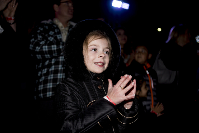 Isabel Tierney, 6, watches Human Nature preform during the 25th annual tree lighting ceremony at Opportunity Village in a helicopter, Friday, Nov. 25, 2016, Las Vegas. (Elizabeth Page Brumley/Las  ...