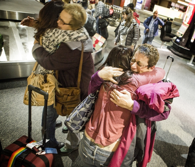 Nancy, left, Kathy, Jaclyn and Debby, declined to give last name, hug in Baggage Claim at McCarran International Airport on Wednesday, Nov. 25, 2015. Jaclyn and Nancy are traveling from San Jose   ...