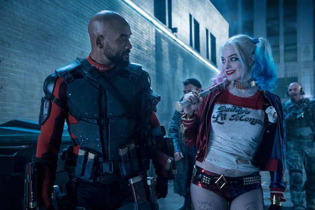 """Will Smith as Deadshot and Margot Robbie as Harley Quinn in """"Suicide Squad."""""""