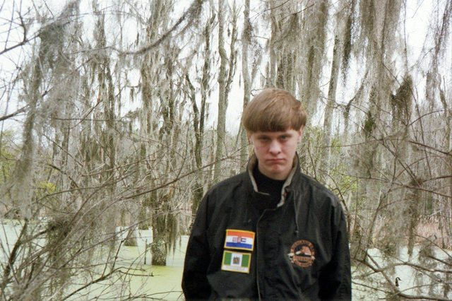 Dylann Roof is pictured in this undated photo taken from his Facebook account in a jacket that bears the flags of apartheid-era South Africa (top) and the former Rhodesia, now Zimbabwe. (Reuters)