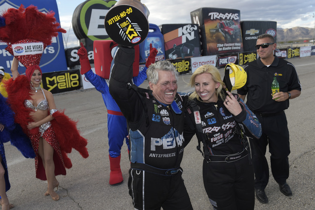 John Force hugs his daughter Courtney Force after defeating her to win the Funny Car class at the NHRA Toyota Nationals on Sunday, Oct. 30, 2016, at The Strip at the Las Vegas Motor Speedway. (Sam ...