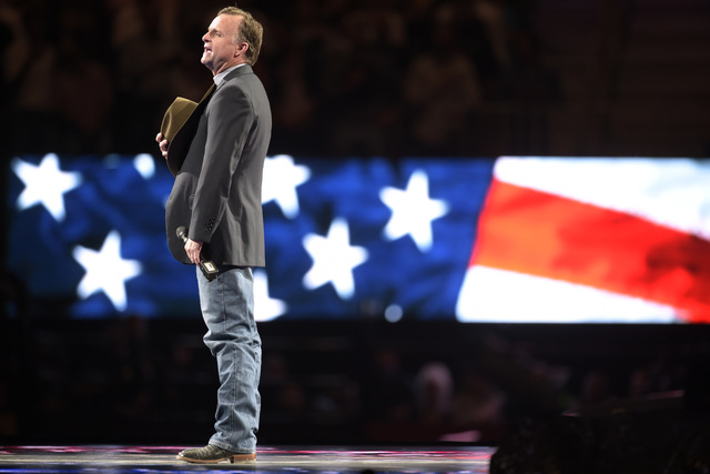 Rodeo entertainer Flint Rasmussen leads the audience in an a cappella rendition of the national anthem during the fourth night of the PBR World Finals on Saturday, Nov. 5, 2016, at T-Mobile Arena  ...