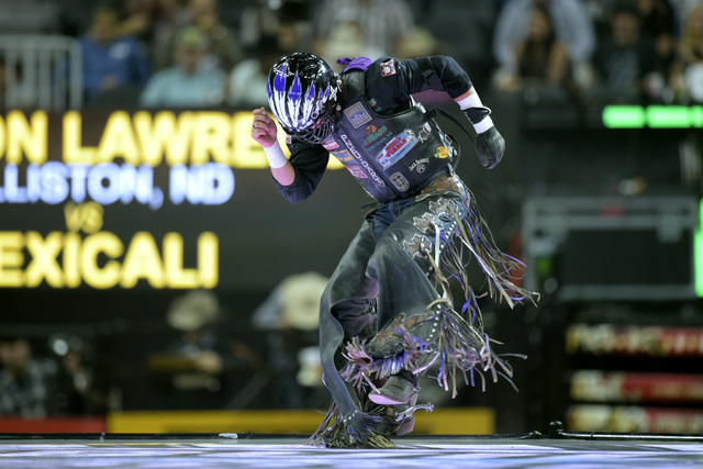 Stetson Lawrence celebrates his successful ride during the fourth night of the PBR World Finals on Saturday, Nov. 5, 2016, at T-Mobile Arena in Las Vegas. (Sam Morris/Las Vegas News Bureau)