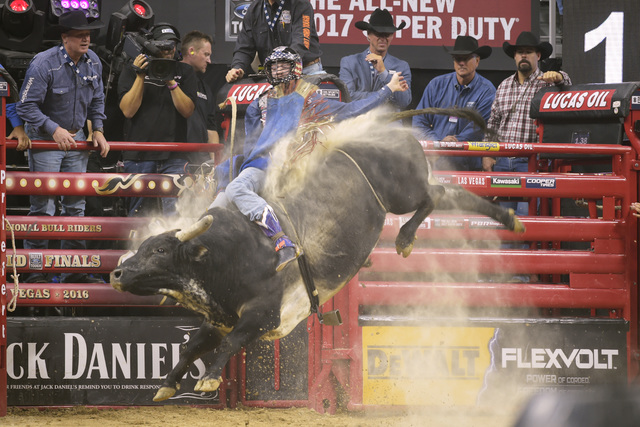 Tanner Byrne rides I'm a Gangster, Too, during the fourth night of the PBR World Finals on Saturday, Nov. 5, 2016, at T-Mobile Arena in Las Vegas. (Sam Morris/Las Vegas News Bureau)