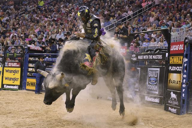 Valdiron de Oliveira rides Flight Plan during the fourth night of the PBR World Finals on Saturday, Nov. 5, 2016, at T-Mobile Arena in Las Vegas. (Sam Morris/Las Vegas News Bureau)