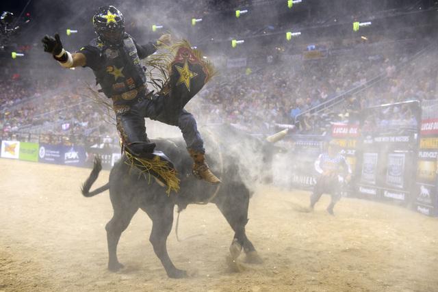 Valdiron de Oliveira gets bucked off Flight Plan during the fourth night of the PBR World Finals on Saturday, Nov. 5, 2016, at T-Mobile Arena in Las Vegas. (Sam Morris/Las Vegas News Bureau)