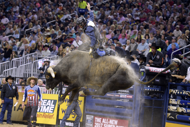 Casey Hayes rides Air Marshall during the fourth night of the PBR World Finals on Saturday, Nov. 5, 2016, at T-Mobile Arena in Las Vegas. (Sam Morris/Las Vegas News Bureau)