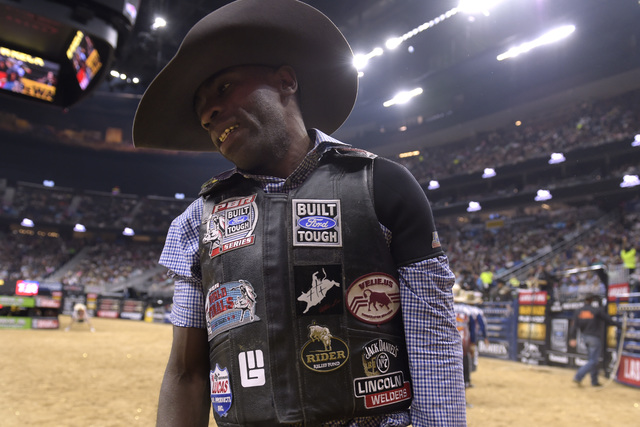 Juliano Antonio Da Silva reacts after coming up short on his ride during the fourth night of the PBR World Finals on Saturday, Nov. 5, 2016, at T-Mobile Arena in Las Vegas. (Sam Morris/Las Vegas N ...