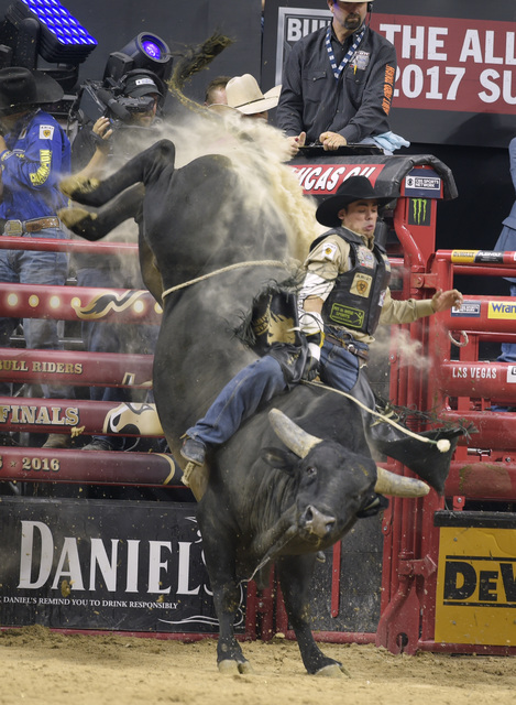 Marco Antonio Eguchi rides Father Shadow during the fourth night of the PBR World Finals on Saturday, Nov. 5, 2016, at T-Mobile Arena in Las Vegas. (Sam Morris/Las Vegas News Bureau)