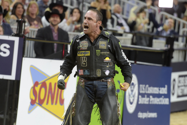 Guilherme Marchi celebrates his third-place ride during the fourth night of the PBR World Finals on Saturday, Nov. 5, 2016, at T-Mobile Arena in Las Vegas. (Sam Morris/Las Vegas News Bureau)