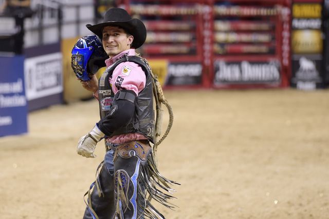 Ryan Dirteater smiles after a successful ride during the fourth night of the PBR World Finals on Saturday, Nov. 5, 2016, at T-Mobile Arena in Las Vegas. (Sam Morris/Las Vegas News Bureau)