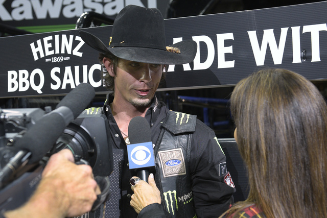 Defending and two-time world champion J.B. Mauney is interviewed after his first-place ride during the fourth night of the PBR World Finals on Saturday, Nov. 5, 2016, at T-Mobile Arena in Las Vega ...