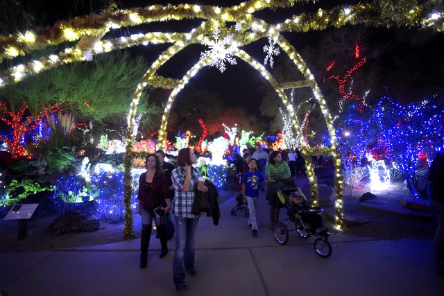 People Wander The Walkways During Annual Cactus Lighting Ceremony At Ethel M Chocolates Tuesday