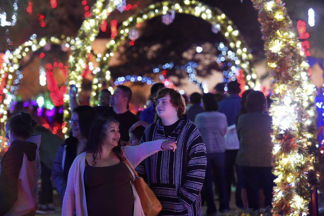 throngs of people crowd the sidewalks during the annual cactus lighting ceremony at ethel m chocolates