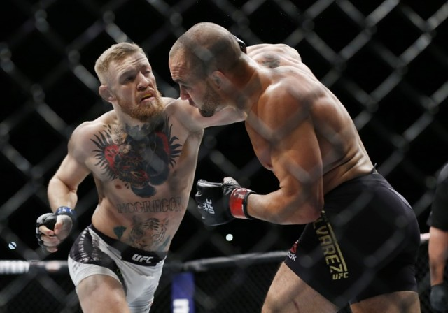 Conor McGregor fights Eddie Alvarez in their lightweight title bout during UFC 205 at Madison Square Garden. (Adam Hunger-USA TODAY Sports)
