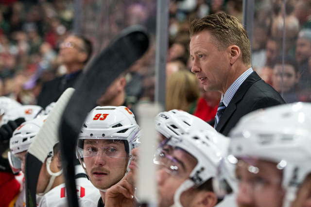 Nov 15, 2016; Saint Paul, MN, USA; Calgary Flames head coach Glen Gulutzan looks on during the second period against the Minnesota Wild at Xcel Energy Center. The Flames defeated the Wild 1-0. Man ...
