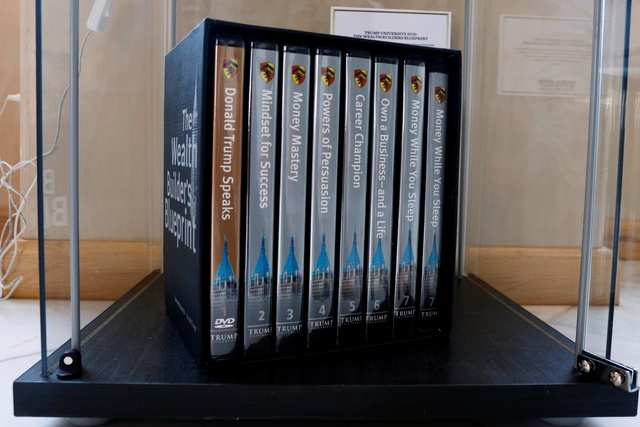 Trump University DVDs are displayed at The Trump Museum near the Republican National Convention in Cleveland on July 19, 2016.  (REUTERS/Lucas Jackson)