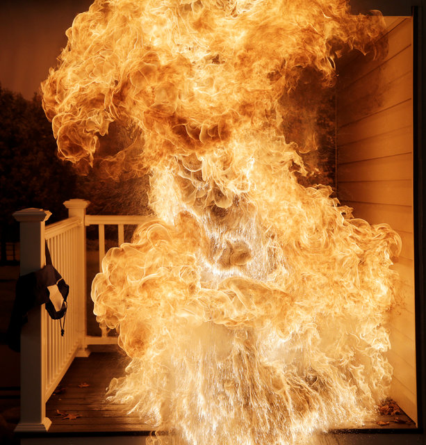 A frozen turkey is dropped into a hot deep fryer, creating a large fireball, at a Consumer Product Safety Commission Thanksgiving fire and food safety demonstration of holiday kitchen fires in Roc ...